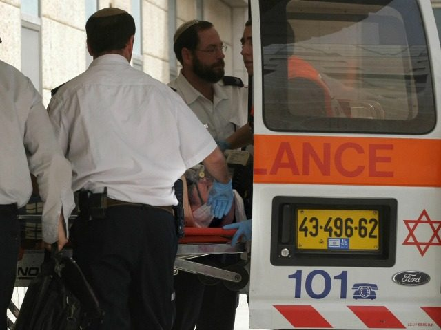 Israeli medics carry a wounded Ultra-nationalist rabbi out of an ambulance after he was stabbed at Jerusalem's Old City Damascus gate, on March 18, 2008 at Hadassah hospital. An ultra-nationalist Israeli rabbi was lightly wounded today after being stabbed near the Damascus gate into Jerusalem's walled Old City, police said. …