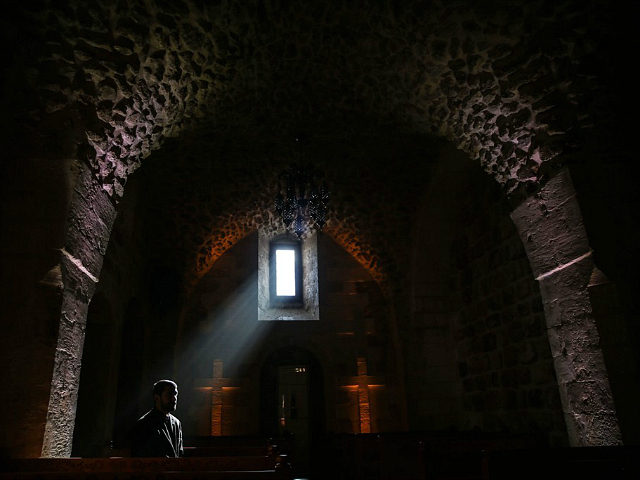 MARDIN, TURKEY - DECEMBER 22: A priest is seen inside of Assyrian Protestant Church located in Mardin province of Turkey on December 22, 2016. Mardin hosts people from different religions and cultures for centuries with historical structures and background. (Photo by Sebnem Coskun/Anadolu Agency/Getty Images)