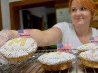 A worker in a bakery in Sevnica, Slovenia shows off a First Lady Melania Trump apple pie. (Photo for Breitbart News/Penny Starr)