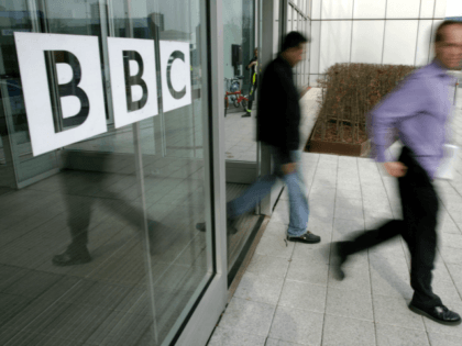 People leave the BBC building, in the corporation's West London headquarters, 21 March 2005.