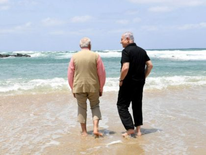 Israel's Prime Minister Benjamin Netanyahu (R) walks with India's Prime Minister Narendra Modi, as they visit Olga Beach and a water desalination unit operated by G.A.L. Water Technologies, near Hadera, Israel July 6, 2017.
