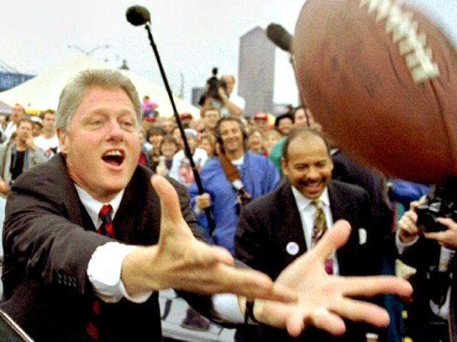 bill.clinton.football.banner.reuters