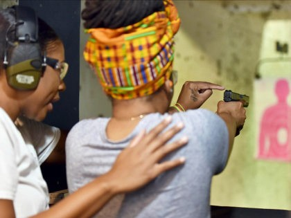 In this May 27, 2017, photo,Marchelle Tigner, a firearms instructor, teaches a student how to shoot a gun during a class in Lawrenceville, Ga. Tigner's goal is to train 1 million women how to shoot a gun in her lifetime. She is among the nation's black women gun owners who …