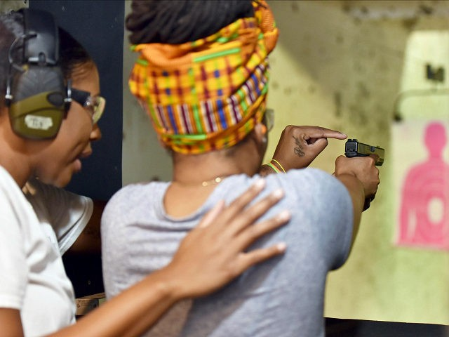 In this May 27, 2017, photo,Marchelle Tigner, a firearms instructor, teaches a student how to shoot a gun during a class in Lawrenceville, Ga. Tigner's goal is to train 1 million women how to shoot a gun in her lifetime. She is among the nation's black women gun owners who say they are picking up firearms for self-protection. (AP Photo/Lisa Marie Pane)