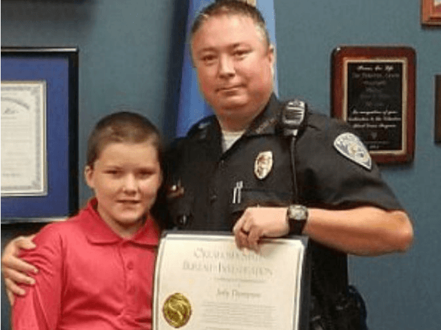 Police officer Jody Thompson and his adopted son John, 10, who was found tied up and beaten in 2015