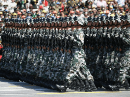 China's People's Liberation Army (PLA) soldiers march past Tiananmen Gate during a military parade in Beijing on September 3, 2015