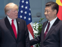 FILE - In this Saturday, July 8, 2017, file photo, U.S. President Donald Trump, left, and Chinese President Xi Jinping arrive for a meeting on the sidelines of the G-20 Summit in Hamburg, Germany. The United States apologized for mistakenly describing Xi as the leader of Taiwan, China said Monday, …