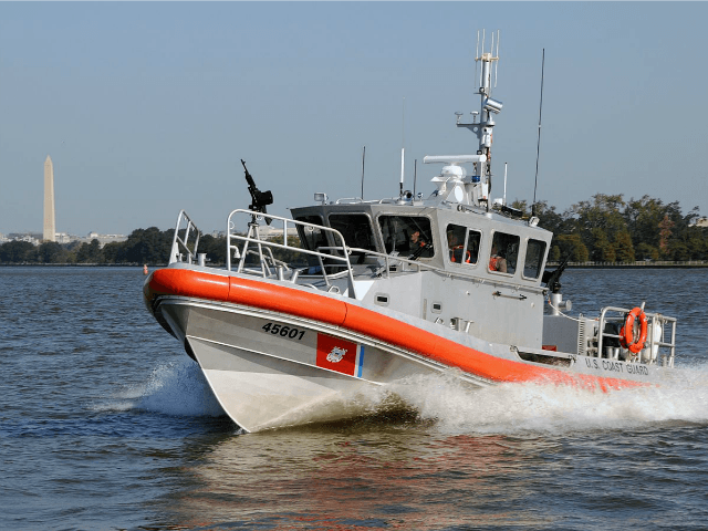 Coast Guard Boat on the Potomac River with the Washington Monument in the Background