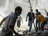 DAMASCUS, SYRIA - JULY 13: Syrians inspect a debris after an Assad Regime's fighter jet fired a vacuum bomb and hit residential areas at the Ein Terma town of Eastern Ghouta, which is a de-conflict zone under control of opponents, in Damascus, Syria on July 13, 2017. (Photo by Ala Muhammed/Anadolu Agency/Getty Images)
