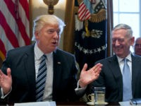 U.S. President Donald trump speaks while James Mattis, U.S. secretary of defense, right, laughs during a meeting with members of the Cabinet at the White House in Washington, D.C., U.S, on Monday, March 13, 2017. Trump said it could take several years for health insurance prices to start to drop under an Obamacare replacement plan he is promoting, creating a rocky transition period that could pose a risk for members of Congress up for re-election next year and Trump's own bid for a second term in 2020. Photographer: Michael Reynolds/Pool via Bloomberg