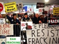ALBANY, NY - JANUARY 08: Anti-fracking protesters gather outside of the auditorium before New York Gov. Andrew Cuomo gives his fourth State of the State address on January 8, 2014 in Albany, New York. Fracking for natural gas has become a contentious issue in New York State and the governor …