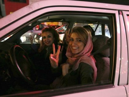 Women in a car flash the 'V for Victory' sign as they celebrate on Valiasr street in northern Tehran on April 2, 2015, after the announcement of an agreement on Iran nuclear talks. Iran and global powers sealed a deal on April 2 on plans to curb Tehran's chances for …
