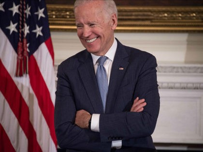 US Vice President Joe Biden laughs as President Barack Obama speaks during a tribute to Biden at the White House in Washington, DC, on January 12, 2017. / AFP / NICHOLAS KAMM (Photo credit should read NICHOLAS KAMM/AFP/Getty Images)