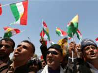 Iraqi Kurdish protesters wave flags of their autonomous Kurdistan region during a demonstration to claim for its independence on July 3, 2014 outside the Kurdistan parliament building in Arbil, in northern Iraq. The Kurdish leader, Massud Barzani asked its parliament to start organizing a referendum on independence. AFP PHOTO / SAFIN HAMED (Photo credit should read SAFIN HAMED/AFP/Getty Images)