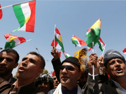 Iraqi Kurdish protesters wave flags of their autonomous Kurdistan region during a demonstration to claim for its independence on July 3, 2014 outside the Kurdistan parliament building in Arbil, in northern Iraq. The Kurdish leader, Massud Barzani asked its parliament to start organizing a referendum on independence. AFP PHOTO / …