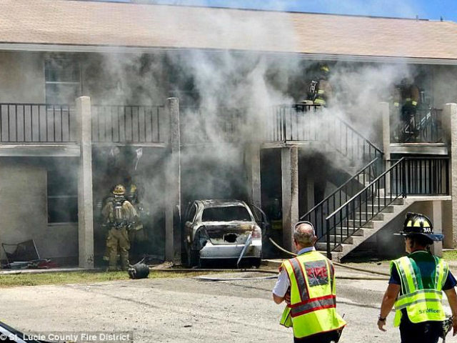 Man drives auto full of propane tanks into apartment