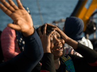 In this Aug. 20, 2016 file picture a woman from Nigeria reacts on the Astral vessel after been rescued by members of Proactiva Open Arms NGO, during a rescue operation at the Mediterranean sea, about 17 miles north of Sabratah, Libya. New and more dangerous smuggling practices and attempts to …