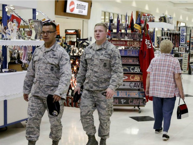 In this May 24, 2017, photo, members of the military and civilians with shopping privileges walk among stores at the Exchange, at Offutt Air Force Base, Neb. Starting in fall 2017, all honorably discharged veterans will be eligible to shop tax-free online at the Exchange with the same discounts they …
