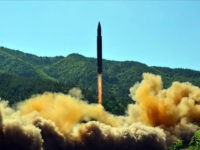 TOPSHOT - This picture taken on July 4, 2017 and released by North Korea's official Korean Central News Agency (KCNA) on July 5, 2017 shows the successful test-fire of the intercontinental ballistic missile Hwasong-14 at an undisclosed location. South Korea and the United States fired off missiles on July 5 …