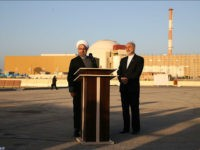 In this photo released by the Iranian Presidency Office, President Hassan Rouhani, left, speaks as he is accompanied by the head of Iran's Atomic Energy Organization Ali Akbar Salehi during his visit to the Bushehr nuclear power plant just outside the port city of Bushehr, southern Iran, Tuesday, Jan. 13, …