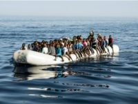 A picture taken on June 27, 2017 shows Libyan coast guardsmen standing in a dinghy carrying illegal immigrants during a rescue operation of 147 people who were attempting to reach Europe, off the coastal town of Zawiyah, 45 kilometres west of the capital Tripoli. More than 8,000 migrants have been …