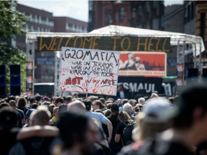 HAMBURG, GERMANY - JULY 06: Demonstrators gather at Hamburg harbor prior to the 'Welcome to Hell' anti-G20 protest march on July 6, 2017 in Hamburg, Germany. Leaders of the G20 group of nations are arriving in Hamburg today for the July 7-8 economic summit and authorities are bracing for large-scale …