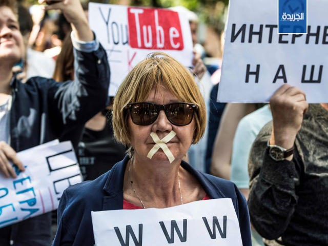 TOPSHOT - A protester with tape covering her mouth takes part in the March for Free Internet in central Moscow on July 23, 2017. / AFP PHOTO / Mladen ANTONOV (Photo credit should read MLADEN ANTONOV/AFP/Getty Images)