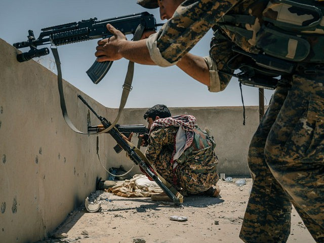 RAQQA, SYRIA, JUNE 12: SDF soldiers take aim at a minaret where they believe an IS sniper is positioned on the western edge of Raqqa city. (Photo Alice Martins for The Washington Post via Getty Images)