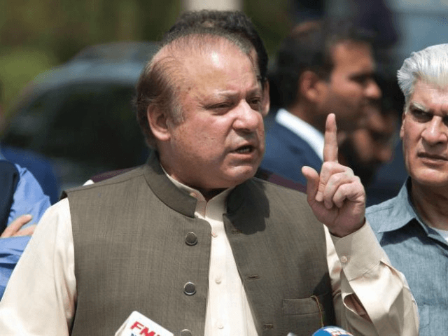 In this Thursday, June 15, 2017, photo, Pakistani Prime Minister Nawaz Sharif speaks to reporters outside the premises of the Joint Investigation Team, in Islamabad, Pakistan. Pakistan's Supreme Court in a unanimous decision has asked the country's anti-corruption body to file corruption charges against Prime Minister Nawaz Sharif, his two …
