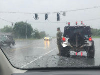 Kentucky Soldier Stands in Pouring Rain to Salute Funeral Procession