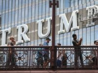 CHICAGO, IL - JUNE 12: Workers install the final letter for a giant TRUMP sign on the outside of the Trump Tower on June 12, 2014 in Chicago, Illinois. Many in the city are opposed to the sign including Mayor Rahm Emanuel who has called it tacky and tasteless. (Photo …