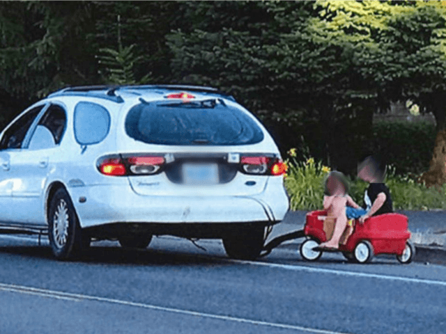 An Oregon mother is accused of using her car to pull three children seated in a plastic wagon.