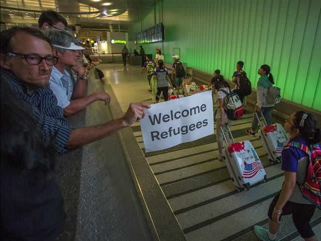 LOS ANGELES, CA - JUNE 29: John Wider carries a welcome sign near arriving international travelers on the first day of the the partial reinstatement of the Trump travel ban, temporarily barring travelers from six Muslim-majority nations from entering the U.S., at Los Angeles International Airport (LAX) on June 29, 2017 in Los Angeles, California. Under a Supreme Court order, foreigners who do not have a so-called 'bona fide relationship' with a person or entity in the United States can be banned. The ban effects travelers from Iran, Libya, Somalia, Sudan, Syria and Yemen. (Photo by David McNew/Getty Images)