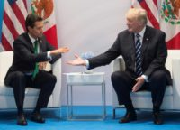 US President Donald Trump (R) and Mexican leader Enrique Pena Nieto held talks on the sidelines of the G20 summit, including the contentious issue of migration