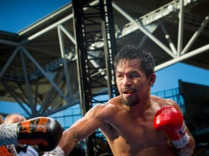 Manny Pacquiao's (R) loss to Jeff Horn has prompted calls that he retires for good