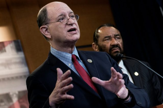 Lawmakers Brad Sherman (L), Democrat of California, and Al Green, Democrat of Texas, take questions last month about articles of impeachment for US President Donald Trump