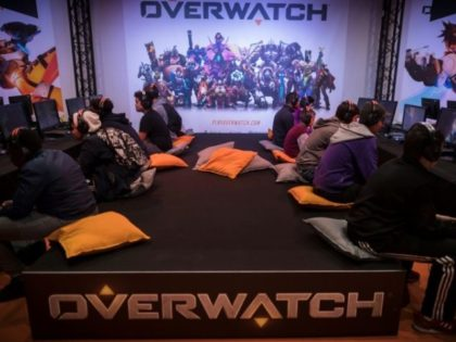 """Visitors play the video game """"Overwatch"""" at the 2016 Paris Games Week. Game developer Activision is creating an eSports league around the game"""