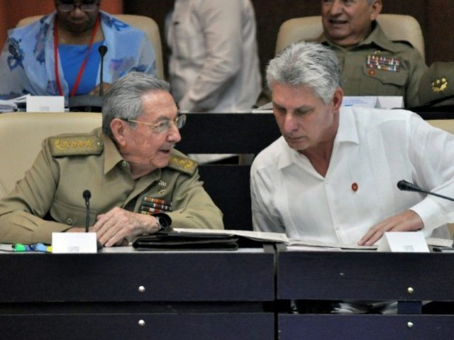 Cuban President Raul Castro (L) and First Vice president Miguel Diaz-Canel speak during the Permanent Working Committees of the National Assembly of the People's Power in Havana, on July 14, 2017