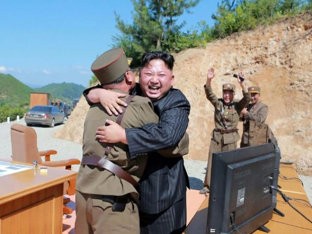 North Korean leader Kim Jong-un seen celebrating the successful test of an intercontinental ballistice missile July 5, which has prompted calls at the UN for tougher sanctions on Pyongyang