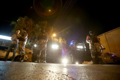Jordanian security forces stand guard outside the Israeli embassy in Amman following an 'incident' on July 23, 2017 in which a Jordanian man was killed and an Israeli seriously injured