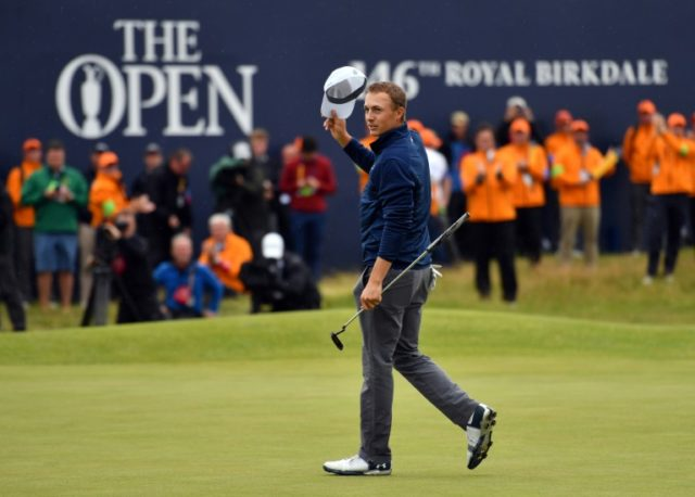 US golfer Jordan Spieth celebrates on the 18th green of the Royal Birkdale golf course on July 23, 2017