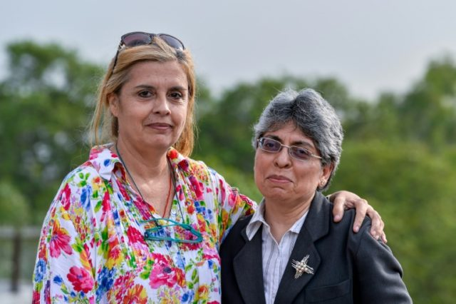Frenchwoman Marie-Emmanuelle Verhoeven poses with her lawyer Ramni Taneja (R) in 2016