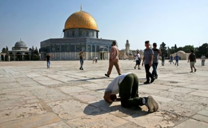 performs a prayer in gratitude to God near the Dome of the Rock in the Haram al-Sharif compound, known to Jews as the Temple Mount, in the Old City of Jerusalem on July 27, 2017, as Palestinians ended an almost two-week boycott