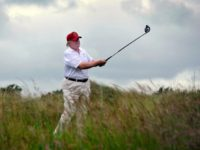 Donald Trump plays a stroke in 2012 as he officially opens his multimillion pound Trump International Golf Links course in Aberdeenshire, Scotland