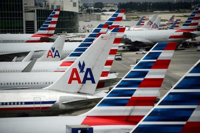 American Airlines reported a dip in second-quarter profits but offered a positive outlook