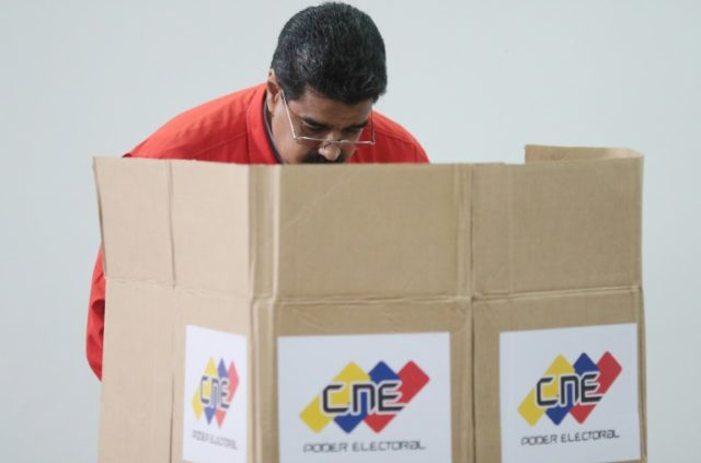 Venezuelan President Nicolas Maduro casting his vote in Caracas on July 30, 2017