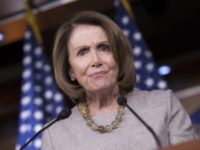 FILE - In this Feb. 16, 2017, file photo, House Minority Leader Nancy Pelosi of Calif. listens during a news conference on Capitol Hill in Washington. The AP reported on July 14, 2017, that a series of stories circulating online regarding a drug bust involving Pelosi's daughters is a hoax. …