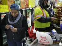 woman-buying-food-with-food-stamps-ebt-card-AP-640x480
