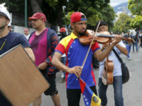 Venezuela's Protesting Violinist Beaten, Burned, Forced to Watch Rape by Soldiers in Prison