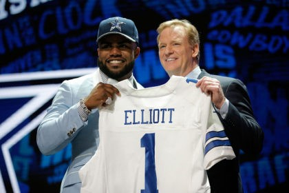 CHICAGO, IL - APRIL 28: (L-R) Ezekiel Elliott of Ohio State holds up a jersey with NFL Commissioner Roger Goodell after being picked #4 overall by the Dallas Cowboys during the first round of the 2016 NFL Draft at the Auditorium Theatre of Roosevelt University on April 28, 2016 in …